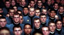 Cadets stand for the national anthem before a speech by U.S. President Barack Obama in Eisenhower Hall at the United States Military Academy at West Point on Dec. 1, 2009. (Chris Hondros/Getty Images)