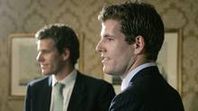 Twin brothers Cameron, left, and Tyler Winklevoss, founders of ConnectU, talk with reporters following a news conference in Boston, Wednesday, July 25, 2007. (Charles Krupa/AP)