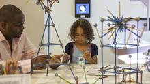 A visitor creates geometric shapes at the Structure Studio exhibit at the National Museum of Mathematics in New York on Aug. 25, 2013. The museum, the only math museum in North America, is filled with 31 colourful and interactive exhibits with children in mind. (EMON HASSAN/NYT)
