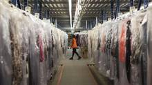 Employees work in the clothing section of The Shopping Channel's national distribution centre in Mississauga on Wednesday, Aug. 28, 2013. (Matthew Sherwood For The Globe and Mail)