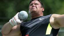 Dylan Armstrong throws to a first place finish in the men's shot put final at the Canadian Track and Field Olympic Trials in Calgary, Alberta, June 30, 2012. (TODD KOROL/REUTERS)