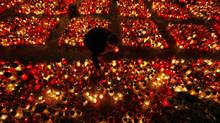 Candles in Warsaw: The country is united in the same way the U.S. was after 9/11 (PETR JOSEK/Reuters)