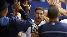 Tampa Bay Rays' Kevin Kiermaier is congratulated after scoring during the sixth inning of a baseball game against the Toronto Blue Jays in St. Petersburg, Fla. (Mike Carlson/Associated Press)
