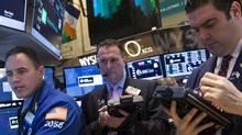 Traders work on the floor of the New York Stock Exchange Feb. 10, 2014. (BRENDAN MCDERMID/REUTERS)