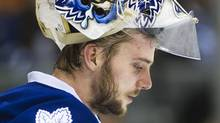 Toronto Maple Leafs goalie Jonas Gustavsson looks down after replacing James Reimer while playing against the Montreal Canadiens during third period NHL hockey action in Toronto on Saturday, Feb. 11, 2012. THE CANADIAN PRESS/Nathan Denette (Nathan Denette/CP)