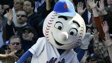 In this April 11, 2005, file photo, New York Mets mascot Mr. Met reacts with the crowd during the Mets home opener against the Houston Astros at Shea Stadium in New York. (GREGORY BULL/AP)