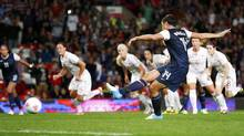 USA's Abby Wambach scores on a penalty kick against Canada in the women's semi final soccer match against at the London 2012 Olympic Games at Old Trafford in Manchester, August 6, 2012 (David Moir/Reuters)