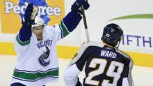 Vancouver Canucks left wing Daniel Sedin (L) celebrates his first period power play goal next t Nashville Predators right wing Joel Ward during Game 6 of the NHL Western Conference semi-final hockey playoff in Nashville, Tennessee May 9, 2011. (M. J. MASOTTI JR./REUTERS)
