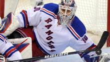 New York Rangers goalie Henrik Lundqvist (30) makes a save against the Ottawa Senators during the second period of game six of first round NHL Stanley Cup playoff hockey action at the Scotiabank Place in Ottawa on Monday, April 23, 2012. THE CANADIAN PRESS/Sean Kilpatrick (Sean Kilpatrick)