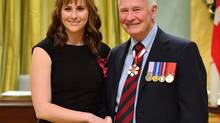 Nicole Louise Foran is pictured with Governor-General David Johnston on Dec. 5, 2013. Ms. Foran received the Star of Courage for her role in disarming an airplane hostage-taker. (Sgt. Ronald Duchesne/Rideau Hall)