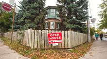 An open house sign is seen on Westmoreland Avenue in Toronto in this 2012 file photo. (JENNIFER ROBERTS For The Globe and Mail)