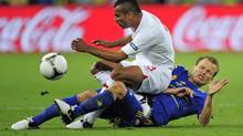England's Ashley Cole, top, and Ukraine's Oleh Gusev vie for the ball during the Euro 2012 soccer championship Group D match between England and Ukraine in Donetsk, Ukraine, Tuesday, June 19, 2012. (Manu Fernandez/AP)