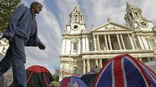 The Occupy London camp area outside St. Paul's Cathedral in London. The rich are rushing to show their solidarity with the Occupy movement by scuttling as quickly as possible away from the other rich. (Sang Tan/Associated Press)