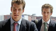 Tyler and Cameron Winklevoss, co-founders of ConnectU Inc., arrive at the U.S. District Court in Boston July 25, 2007 for a court hearing on ConnectU's lawsuit against Facebook Inc. (BRIAN SNYDER)