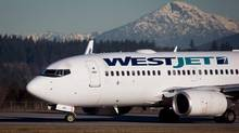 A pilot taxis a Westjet Boeing 737-700 in Richmond, February 3, 2014. THE CANADIAN PRESS/Darryl Dyck