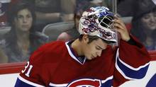 Montreal Canadiens goalie Carey Price takes a break during his NHL pre-season hockey play against the Boston Bruins in Montreal September 22, 2010. (SHAUN BEST)