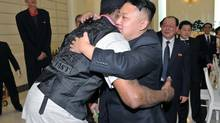 North Korean leader Kim Jong-Un and former NBA basketball player Dennis Rodman (front L) hug in Pyongyang in this undated picture released by North Korea's KCNA news agency. KCNA reported that a mixed basketball game of visiting U.S. basketball players and North Korean players was held at Ryugyong Jong Ju Yong Gymnasium on February 28, 2013. (KCNA/REUTERS)