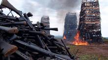 Rwandan weapons burn near the capital of Kigali in this photo from 2005. Rwanda burnt guns, mortar tubes and ammunition to show its commitment to a regional plan to staunch the flow of arms fuelling conflicts in Africa. (REUTERS)