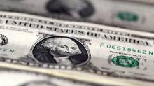 The dollar charged to an almost 14-year high and government bond yields rose sharply on Thursday, after the Federal Reserve hiked U.S. interest rates. (© Dado Ruvic / Reuters)