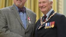 Governor General David Johnston invests, Michael Enright, from Toronto, Ont., as a Member of the Order of Canada during a ceremony at Rideau Hall Friday November 22, 2013 in Ottawa. (Adrian Wyld/THE CANADIAN PRESS)