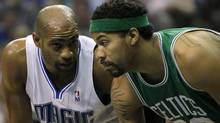 Vince Carter #15 of the Orlando Magic lines up next to Rasheed Wallace #30 of the Boston Celtics as they wait for a free throw attempt in Game One of the Eastern Conference Finals during the 2010 NBA Playoffs at Amway Arena on May 16, 2010 in Orlando, Florida. NOTE TO USER: User expressly acknowledges and agrees that, by downloading and/or using this Photograph, user is consenting to the terms and conditions of the Getty Images License Agreement. (Photo by Doug Benc/Getty Images) (Doug Benc/2010 Getty Images)