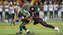 Ottawa Redblacks' Jerrell Gavins tries to tackles Edmonton Eskimos' Adarius Bowman during CFL action in Ottawa on Friday Aug. 15. (Sean Kilpatrick/THE CANADIAN PRESS)