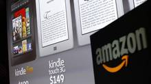 Graphics of the new Amazon Kindle tablets are seen at a news conference during the launch of Amazon's new tablets in New York, in this September 28, 2011, file photo. (SHANNON STAPLETON/REUTERS)