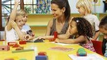 Early childhood educators told us they are passionate about their jobs but find the low pay to be a drawback. (Stockbyte/Getty Images)