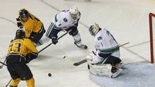 Vancouver Canucks goalie Roberto Luongo (1) blocks a shot on goal during the first period of their NHL hockey game against the Nashville Predators in Nashville, Tennessee February 22, 2013. (HARRISON MCCLARY/REUTERS)