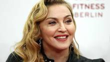 U.S. pop star Madonna smiles during her visit at the Hard Candy Fitness center in Berlin. (MICHAEL SOHN/AP)