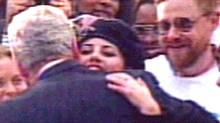 Former White House intern Monica Lewinsky hugs President Clinton at the White House, November 6 1996 during a ceremony gathering the White House interns (REUTERS)