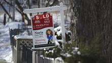 A 'sold' sign sits on the front lawn of a Toronto home in this file photo. (Fred Lum/Fred Lum/The Globe and Mail)