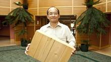 What we're doing now is putting some effort into this renaissance in wood,' said Conroy Lum, research leader for structural performance at FPInnovations, seen here holding a block of cross-laminated timber. (Mark Philps for The Globe and Mail)