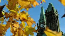 Autumn leaves frame the Peace Tower in Ottawa on Oct. 18, 2011. (Sean Kilpatrick/THE CANADIAN PRESS)