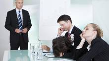 Bored businesswoman sleeping in a meeting (Andrey Popov/Getty Images/iStockphoto)