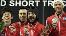 Canada's team Michael Gilday, Charles Hamelin, Olivier Jean and Charle Cournoyer celebrate on the podium (LASZLO BALOGH/REUTERS)