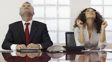 Bored colleagues playiwith pencils at a meeting. (diego cervo/Getty Images/iStockphoto)