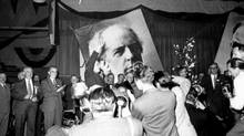 Against backgournd of a huge portrait of former Liberal leader, Sir Wilfrid Laurier behind the platform, Louis St. Laurent, receives an ovation, other cabinet ministers behind him, just after the announcement of his election as leader of the Liberal Party of Canada, late Saturday afternoon, August 7, 1948. (The Globe and Mail)