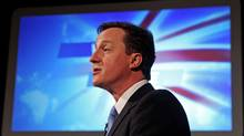 British Conservative Leader David Cameron delivers his election manifesto to an audience in Prestatyn, Wales, on April 16, 2010. (OLI SCARFF)
