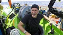 James Cameron emerges from the Deepsea Challenger submersible after his successful solo dive to the Mariana Trench, the deepest part of the ocean, March 26, 2011. (Mark Theissen / National Geographic/AP)