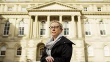 Breese Davies, standing outside of Osgoode Hall in Toronto on Tuesday, argues in favour of keeping the program. (Peter Power/The Globe and Mail)