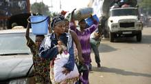 Thousands of Muslim residents from Bangui and Mbaiki flee the Central African Republic on Friday, Feb. 7, 2014. (Jerome Delay/Associated Press)