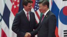 Justin Trudeau is greeted by Chinese President Xi Jinping during the official welcome at the G20 Leaders Summit in Hangzhou last year. The Liberal government, against the advice of national security agencies, is allowing a Chinese takeover of a Montreal high-tech firm. (Adrian Wyld/The Canadian Press)