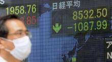 Japan's Nikkei 225 stock index plunged 10.6 per cent on Tuesday, its worst day since October, 2008. (KYODO/REUTERS)