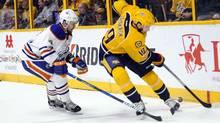 Nashville Predators centre Calle Jarnkrok steals the puck from Edmonton Oilers defenceman Kris Russell on Feb. 26, 2017. (Steve Roberts/USA Today Sports)