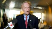 Former prime minister Jean Chrétien speaks to reporters in Montreal on April 14, 2011. (Graham Hughes/The Canadian Press)
