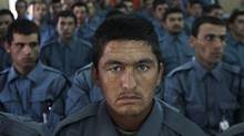 Afghan national police officers attend their graduation ceremony on Aug. 30. U.S. forces have suspended the training of local police forces in the country. (Rahmat Gul/Associated Press)