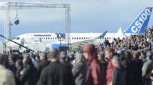 Crowds gather to take a look at Bombardier's C-Series commercial jet on Monday, Sept. 16, 2013 in Montreal. The Montreal-based company acknowledged yet another delay in the C Series jet introduction, to the second half of 2015. (Ryan Remiorz/THE CANADIAN PRESS)