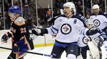 Winnipeg Jets' Mark Stuart reacts after New York Islanders' Kyle Okposo (21) scored against Jets goalie Chris Mason (50) in the second period of an NHL hockey game on Thursday, April 5, 2012, in Uniondale, N.Y. (AP Photo/Kathy Kmonicek) (Kathy Kmonicek/AP)