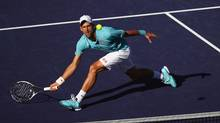 Novak Djokovic plays a forehand volley during his match against Nick Kyrgios during day ten of the BNP Paribas Open at Indian Wells Tennis Garden on March 15, 2017 in Indian Wells, California. (Clive Brunskill/Getty Images)